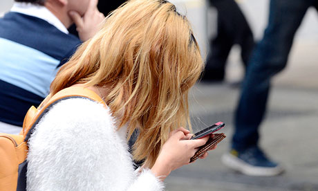 Young woman looks at phone